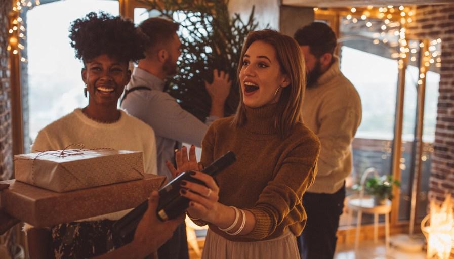 Women receiving a bottle of wine