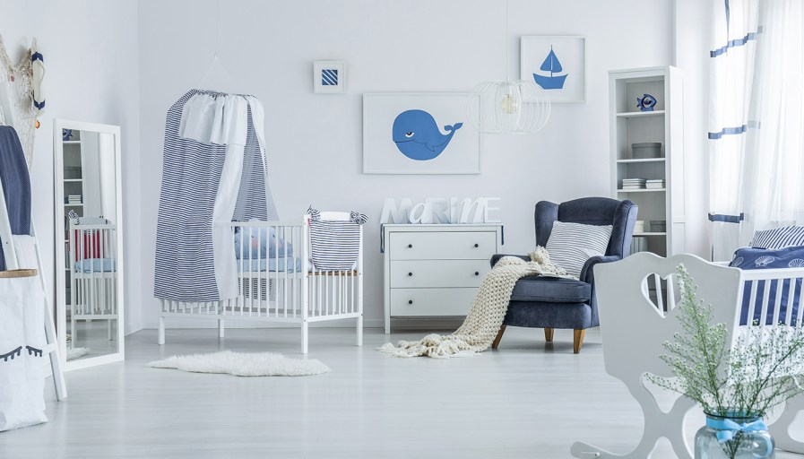 Baby boy nursery with crib and chair