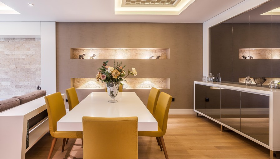 Dining room with white table and mustard yellow chairs