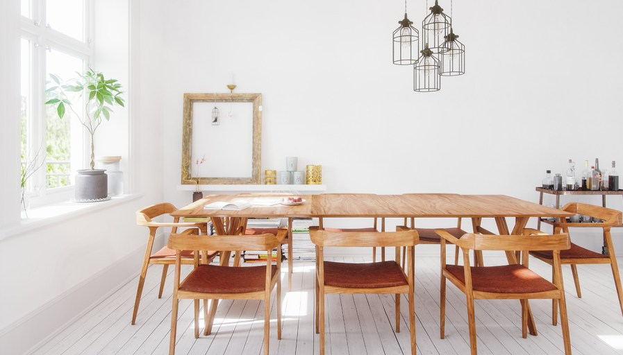 White dining room with wooden table set