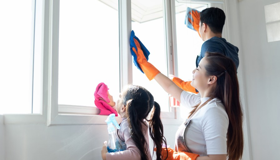 A family washing windows.