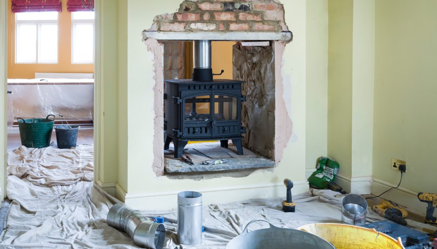 Antique fireplace inside a wall to be used in two rooms in a home.