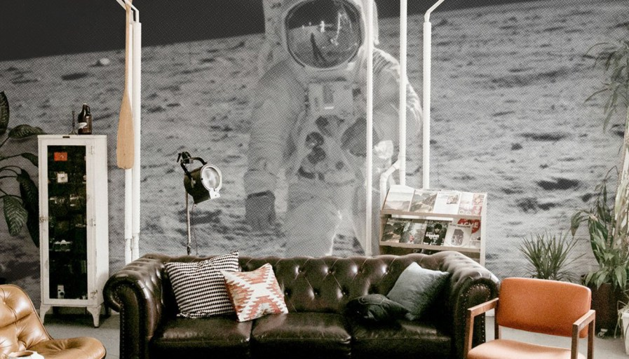 A space themed mural in a living room.