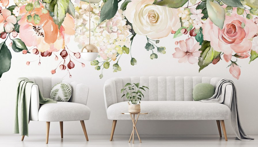 Giant flowers on the wall make for a beautiful backdrop to living room couches.