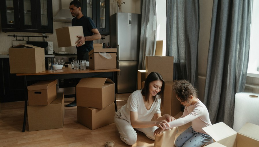 A mother and daughter packing to move.
