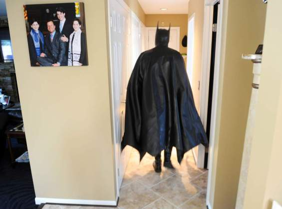 OWINGS MILLS, MD    March 27: Leonard Robinson  is known as batman to children in area hospitals where he visits and hands out batman hats, shirts, backpacks and other things to brighten their days. Photographed at his home on March 27, 2012 in Owings Mills, MD    (Photo by Jonathan Newton/The Washington Post via Getty Images)
