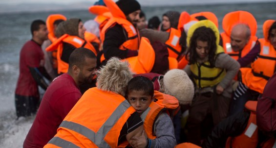 A rubber boat filled with migrants and refugees arrives at a beach on the northern coast of Lesbos, Greece, Saturday, Oct. 31, 2015. An official leading rescue efforts on the Greek island of Lesbos has warned that the death toll in the eastern Aegean Sea is likely to rise in the coming days unless urgent action is taken to stop smugglers in nearby Turkey. (AP Photo/Marko Drobnjakovic)