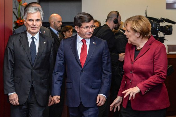 epa05047509 Austrian Chancellor Werner Faymann (L-R), Turkish Prime Minister Ahmet Davutoglu, and German Chancellor Angela Merkel talk at the start of an EU-Turkey Summit in Brussels, Belgium, 29 November 2015. The European Union hopes to secure Ankara's concrete help in stemming a surge in migration, at a joint summit in Brussels, with the bloc offering financial aid and closer ties in return. Europe is facing its largest people movements since World War II, with almost 900,000 migrants and asylum seekers arriving this year. Many, including large numbers from war-torn Syria, transit through Turkey and board boats headed for Greece.  EPA/STEPHANIE LECOCQ