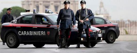 Italian Carabinieri pose in front of St. Peter's Basilica as a Carabinieri helicopter flies overhead, in Rome