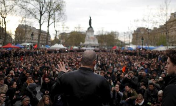 """Former Greek Finance Minister Yanis Varoufakis speaks in front of supporters of social media-driven movement """"Nuit Debout"""" (Up All Night), during their daily gathering on the Place de la Republique in Paris"""