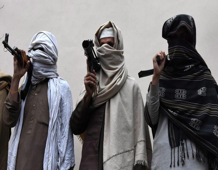 Former Taliban militants surrender as part of reconciliation initiative