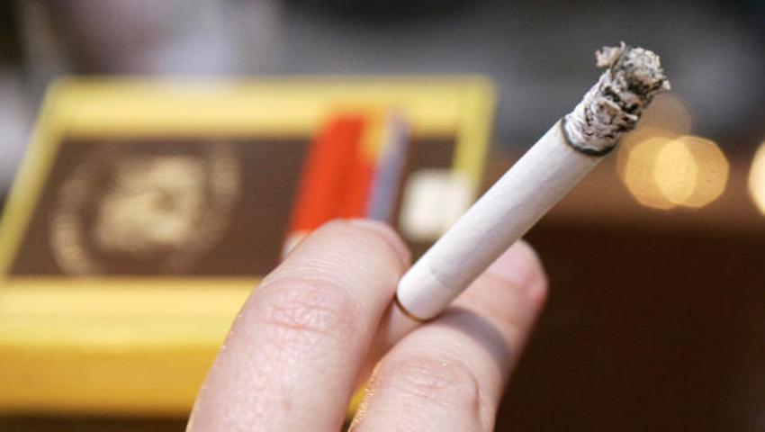 Joanne Hinkel holds a cigarette during t