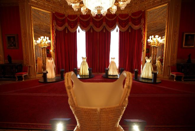 Dresses worn by Britain's Queen Elizabeth are seen on mannequins in the Crimson Drawing Room at Windsor Castle in Windsor