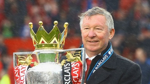 Manchester United's Sir Alex Ferguson with the Premier League trophy at Old Trafford on May 12, 2013 in Manchester, England.