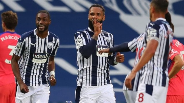 Kyle Bartley celebrates with team-mates after West Brom take a 3-0 lead against Chelsea