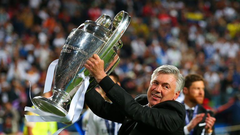 Carlo Ancelotti celebrates with the Champions League trophy.