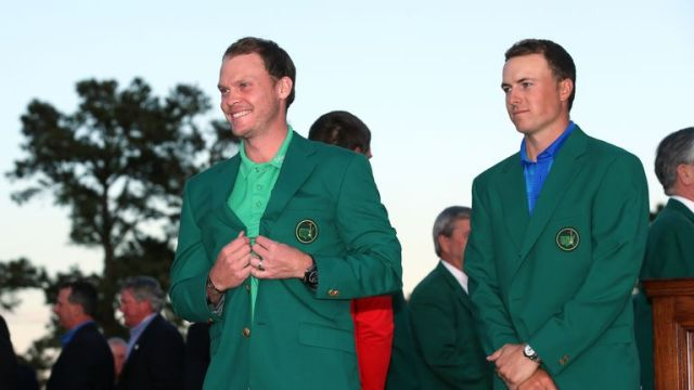 Spieth put on a brave face as he presented Danny Willett with the Green Jacket