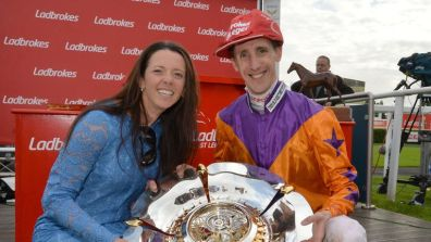 Laura Mongan picks up her St Leger silverware alongside winning jockey George Baker