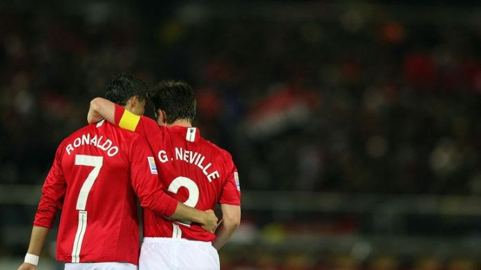 Cristiano Ronaldo of Manchester United celebrates scoring the second goal with his teammate Gary nevilleduring the FIFA Clu