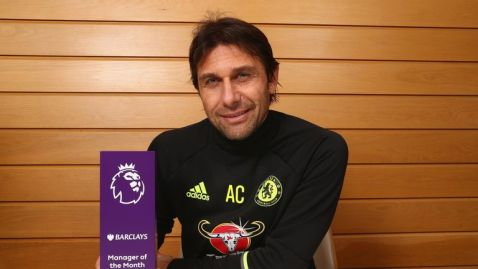 Chelsea manager Antonio Conte poses with the Premier League manager-of-the-month award