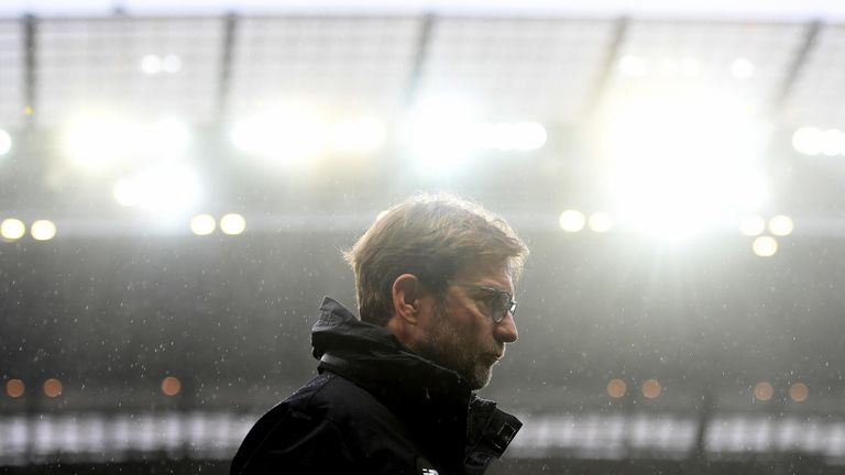 Jurgen Klopp makes his way to the dugout prior to kick-off