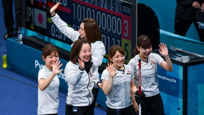 Japan's players celebrate after winning the bronze medal game