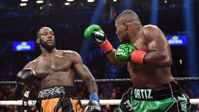 Luis Ortiz (R) was beaten by Deontay Wilder in March