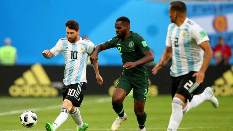 Messi is challenged by Nigeria's Bryan Idowu