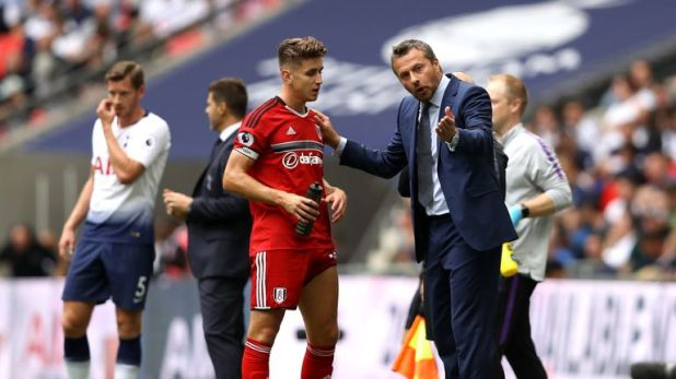 The midfielder receives instructions from manager Slavisa Jokanovic