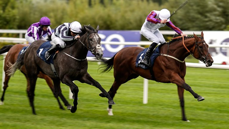 Daniel Tudhope riding Laurens (r) to victory over Alpha Centauri in the Coolmore Fastnet Rock Matron Stakes