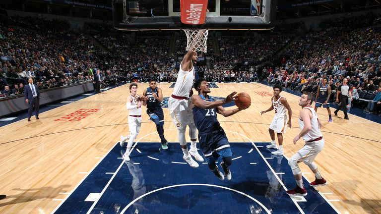 Jimmy Butler of the Minnesota Timberwolves goes to the basket against the Cleveland Cavaliers