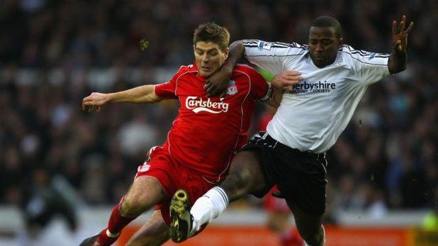Johnson competing in Premier League action against Steven Gerrard