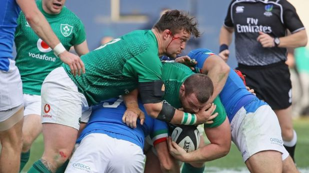 Andrew Porter (L) helps Jack McGrath as he is tackled by George Fabio Biagi and Luca Bigi