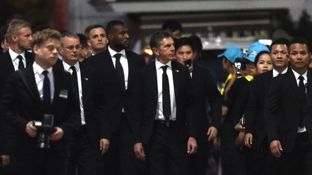 Leicester manager Claude Puel (centre) gave his squad the freedom to make decisions on how they marked the death of Srivaddhanaprabha