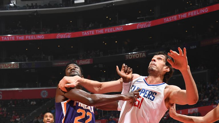 LOS ANGELES, CA - NOVEMBER 28: Deandre Ayton #22 of the Phoenix Suns and Boban Marjanovic #51 of the LA Clippers fight for position on November 28, 2018 at STAPLES Center in Los Angeles, California. NOTE TO USER: User expressly acknowledges and agrees that, by downloading and/or using this Photograph, user is consenting to the terms and conditions of the Getty Images License Agreement. Mandatory Copyright Notice: Copyright 2018 NBAE (Photo by Andrew D. Bernstein/NBAE via Getty Images)