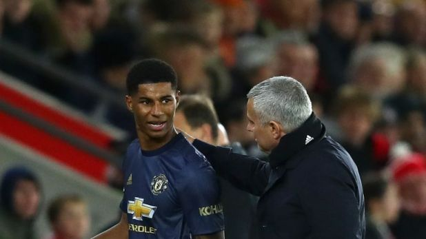 Marcus Rashford speaks to Jose Mourinho after being substituted