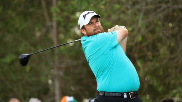 Shane Lowry holds a one-shot lead after an opening 65