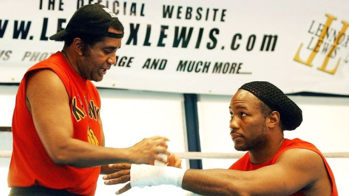 Lennox Lewis met with coach Emanuel Steward in the Pocono Mountains