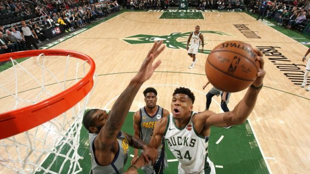 Giannis Antetokounmpo finishes at the rim against Indiana