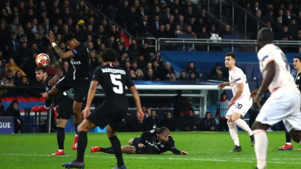 VAR awarded Manchester United a penalty when the ball hit Prenel Kimpebe's right arm in stoppage time