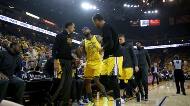 DeMarcus Cousins #0 of the Golden State Warriors is helped off the court after injuring himself against the LA Clippers during Game Two of the first round of the 2019 NBA Western Conference Playoffs at ORACLE Arena on April 15, 2019 in Oakland, California.