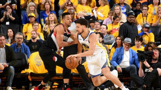 Klay Thompson #11 of the Golden State Warriors handles the ball against CJ McCollum #3 of the Portland Trail Blazers during Game One of the 2019 Western Conference Finals of the NBA Playoffs at the ORACLE Arena on May 14, 2019 in Oakland, California.