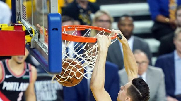 Zach Collins #33 of the Portland Trail Blazers dunks the ball during the first half against the Golden State Warriors in game one of the NBA Western Conference Finals at ORACLE Arena on May 14, 2019 in Oakland, California.