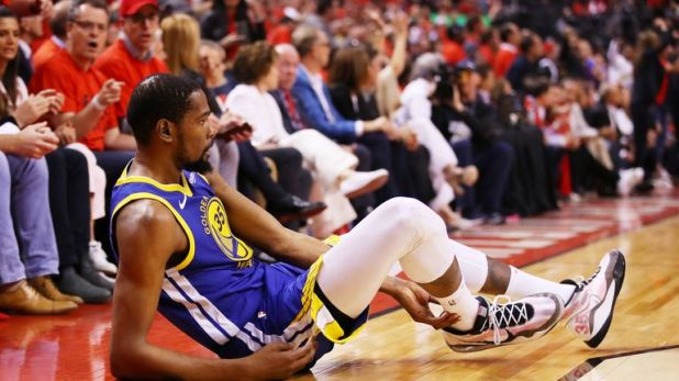 Kevin Durant pictured after aggravating a lower leg injury in Game 5 of the NBA Finals