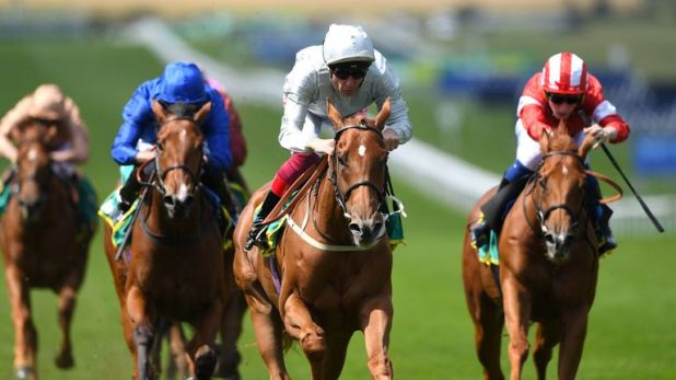 Raffle Prize ridden by jockey Frankie Dettori (centre) on his way to winning the Duchess of Cambridge Stakes