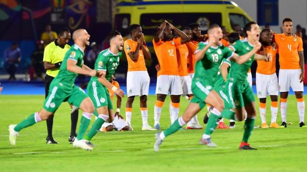Algerian players celebrate after winning their AFCON quarter-final clash with the Ivory Coast