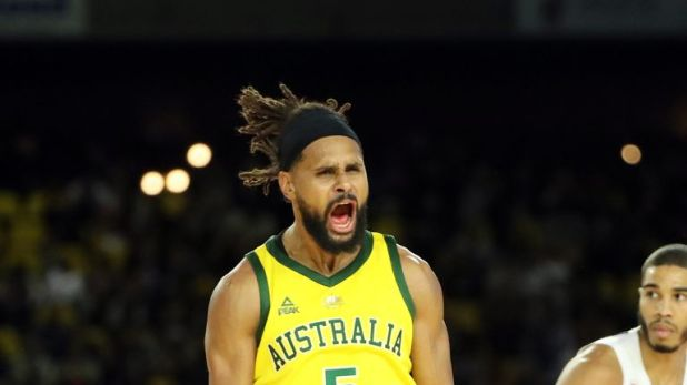 Patty Mills celebrates a basket in Australia's win over Team USA