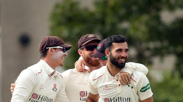 Saqib Mahmood (R) took the final wicket to wrap up Lancashire's win over Glamorgan