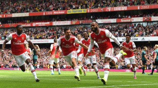 Lacazette celebrates scoring against Burnley with team-mate Ceballos