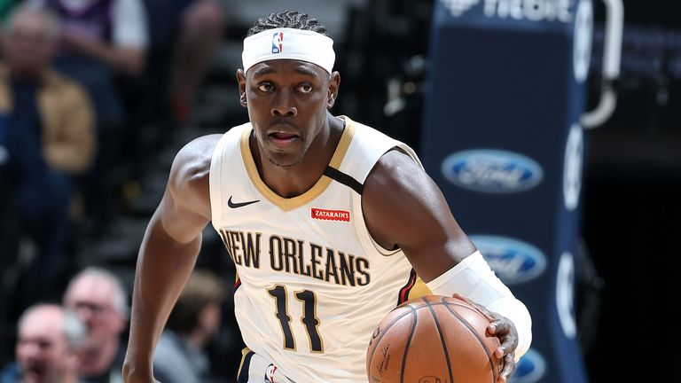 Jrue Holiday of the New Orleans Pelicans handles the ball against the Minnesota Timberwolves